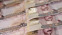 Arab Money Bahrain. .Zenithal pan over money bills. Ascendent movement. Stock Footage