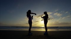 Asian Chinese American friends jogging in summer on beach for sport fitness Stock Footage