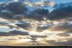 Sunset shining through the clouds on the Spanish island of Fuerteventura - stock photo