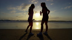 Asian Chinese Caucasian women together at dawn doing cardio training on beach Stock Footage