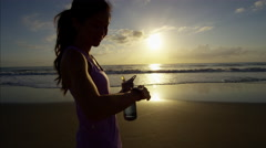 Asian Chinese woman in summer resting and rehydrating after cardio training Stock Footage