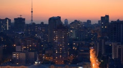 Aerial view of night city Kyiv, Kiev, with car traffic at sunset - stock footage