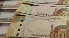 Money Bahrain. Zenithal pan over money bills. Descendent movement.  Stock Footage