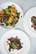 Griddled sweet potato and lambs liver salad with bacon, overhead view Stock Photos
