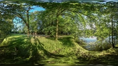 360Vr Video People Cyclist Walkers Near River Walking by Lake Bank Smooth Water Stock Footage