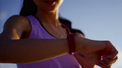 Asian Chinese female with wearable technology to monitor cardiovascular workout Stock Footage
