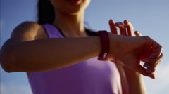 American girl outdoor training to monitor fat burning targets with sport watch Stock Footage