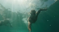 Male diver swims under water in the sea Stock Footage