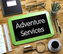Small Chalkboard with Adventure Services Concept - stock illustration