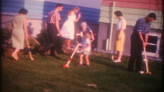 3397 family & friends play croquet on lawn in suburbia-vintage film home movie - stock footage
