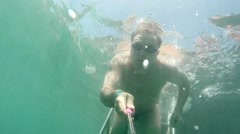 Male swimmer diver swims under water in the sea. Underwater survey shooting Stock Footage