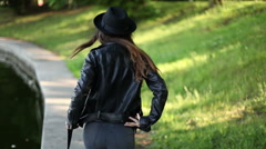Girl walking in the park. summer Stock Footage