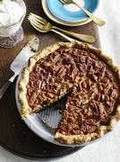 High angle view of pecan pie with slice missing Stock Photos