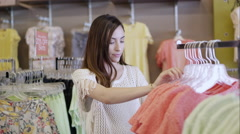 Young woman shopping for clothes Arkistovideo