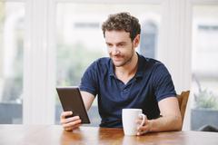 Man using a digital tablet Stock Photos