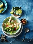 Overhead view of kaffir lime tom yum soup Stock Photos