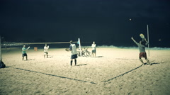 Beach tennis game at night on copacabana beach in rio Stock Footage