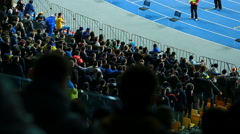 Male football fans jumping on tribunes and chanting slogans, active supporters Stock Footage
