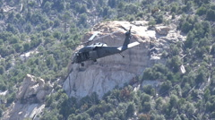 HD blackhawk fly by tracking behind trees w sound Stock Footage