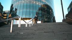 Businessman slide the rail Stock Footage