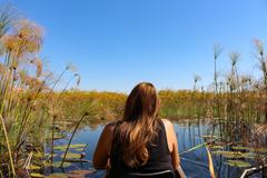 Woman from behind at Mokoro tour, Botswana, Okavango Delta, Safari, lunch, Stock Photos