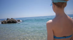 Sexy back of a beautiful woman on tropical beach in blue bikini - stock footage
