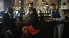 4K Young couple chatting & bartender serving drinks in trendy city bar Stock Footage