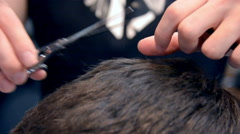 Barber Cuts the Hair with scissors in the Barbershop. Close Up Stock Footage