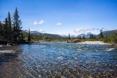 View of river and distant mountains, Ural mountains, Russia Stock Photos