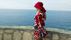 Romantic Fashionable caucasian lady female holidaymaker tourist is in a hat Stock Footage