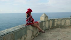 Romantic Fashionable caucasian lady female in red hat,  holiday sea vacation  Stock Footage