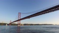 Suspension bridge 25 de abril over the tagus river in lisbon, steady gimbal 4k Stock Footage