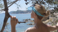 Rear view of relaxed woman on summer travel vacation to the coast sea Stock Footage