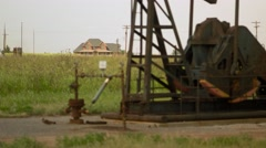 Abandoned Oil Well Too Close to New Home Rack Focus Stock Footage