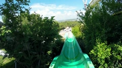 Water park. Downhill with the water slide at a aquapark. Shooting extreme cam  - stock footage
