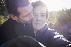Tender sunlit portrait of adult couple Stock Photos