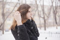 Young woman playing with her hair, wintry background Stock Photos