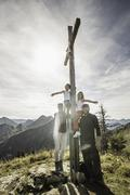 Portrait of couple with two daughters at religious cross, Achenkirch, Austria Stock Photos