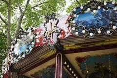 Low angle detail of ornate carousel - stock photo