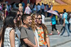 Group poses for a photo in the Forbidden City of Beijing - stock photo