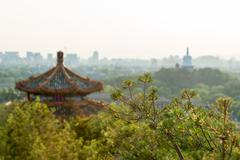 View from the pagoda in Jiang Park with the White Pagoda in the background - stock photo