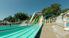 Water park. Vacationers on Extreme Downhill with the water slide at aquapark - stock footage