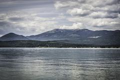 View of lake and mountain, Sandpoint, Idaho, USA Stock Photos