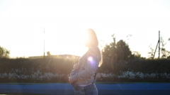 Pregnant woman in the summer nature meadow with in sunset Stock Footage
