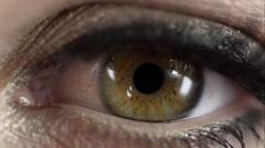 Macro view of woman's eye blinking Stock Footage