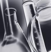 Volumetric laboratory glassware used in a chemistry lab, close-up - stock photo