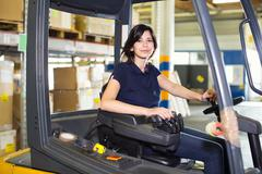 Portrait of female forklift truck driver working in distribution warehouse Kuvituskuvat