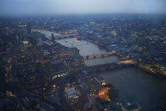 Aerial cityscape of river Thames and bridges at dawn, London, England, UK - stock photo