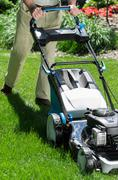 Fast way of mowing the grass - stock photo