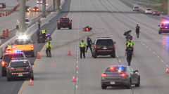 Deadly fatal motorcycle accident scene on highway 407 in Vaughan Stock Footage